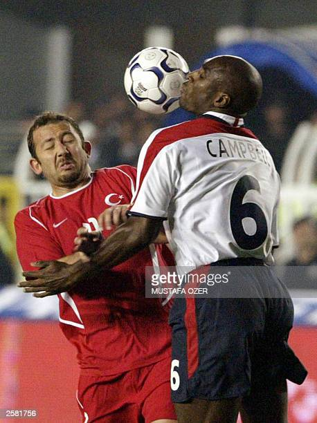 Turkey's Sergen Yalcin fights for the control of the ball with England`s Sol Campbell during their Euro 2004 qualifying match in Sukru Saracoglu...