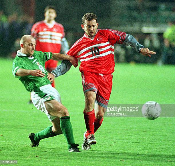 Turkey's Sergen Yalcin holds off Ireland's Lee Carsley in a Euro 2000 qualifying match at Lansdowne Road Dublin 13 November 1999