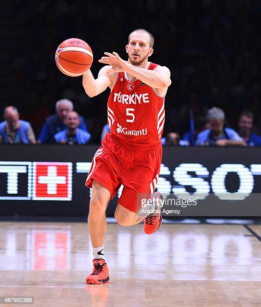 Turkey's Sinan GŸler vies during the EuroBasket 2015 Round of 16 match between France and Turkey at the Pierre Mauroy Stadium in Lille on September...