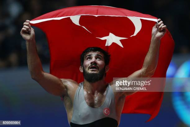 Turkey's Soner Demirtas celebrates after winning the men's freestyle wrestling 74kg category bronze medal final at the FILA World Wrestling...