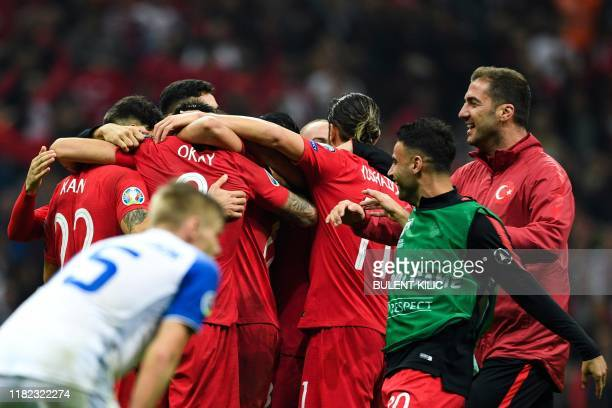 Turkey's team players celebrate at the end of the UEFA Euro 2020 qualifying Group H group match between Turkey and Iceland at Turk Telekom Stadium in...