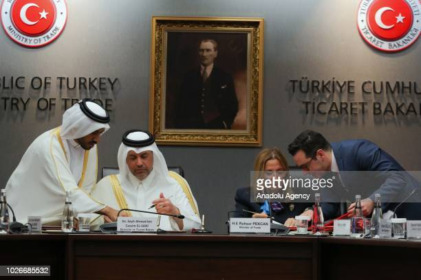 Turkey's Trade Minister Ruhsar Pekcan and Qatar's Economy and Commerce Minister Sheikh Ahmed bin Jassim bin Mohammed Al Thani gather at the signing...