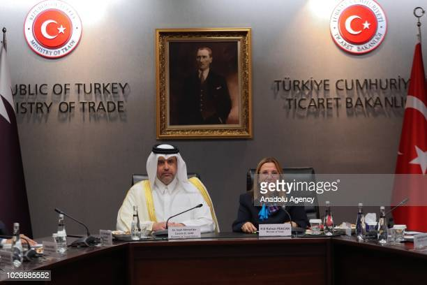 Turkey's Trade Minister Ruhsar Pekcan and Qatar's Economy and Commerce Minister Sheikh Ahmed bin Jassim bin Mohammed Al Thani speak at the signing...