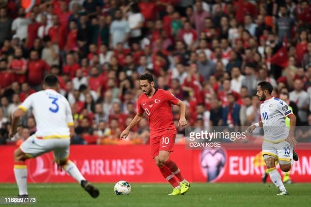 Turkey's Turkish midfielder Hakan Calhanoglu vies with Andorra's defender Marc Vales and midfielder Ludovic Clemente during the UEFA Euro 2020...