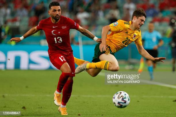 Turkey's Umut Meras vies with Wales' midfielder Daniel James during the UEFA EURO 2020 Group A football match between Turkey and Wales at the Olympic...