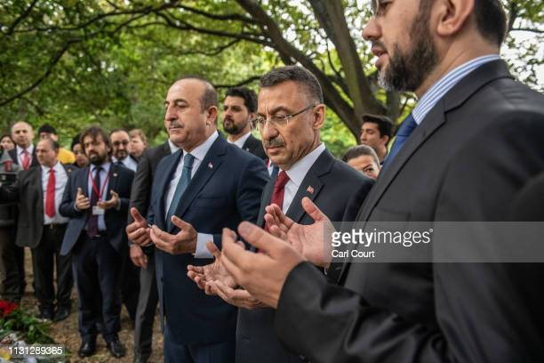 Turkey's Vice-President Fuat Oktay and Foreign Minister Mevlut Cavusoglu pray near Al Noor mosque on March 18, 2019 in Christchurch, New Zealand. 50...
