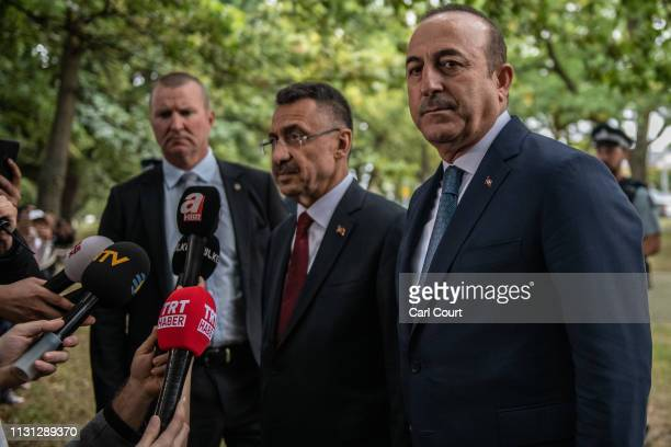 Turkey's VicePresident Fuat Oktay and Foreign Minister Mevlut Cavusoglu speak to the media after visiting Al Noor mosque on March 18 2019 in...