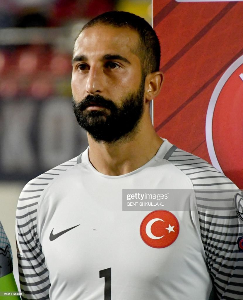 Turkey's Volkan Babacan looks on prior the FIFA World Cup 2018 qualification football match between Kosovo and Turkey in Loro Borici stadium in the city of Shkoder on June 11, 2017. / AFP PHOTO / Gent SHKULLAKU
