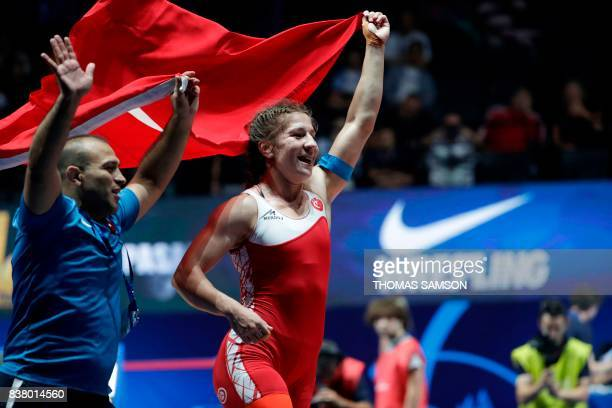 TOPSHOT Turkey's Yasemin Adar celebrates after she won against Belarus' Vasilisa Marzaliuk during the women's freestyle wrestling 75kg category final...