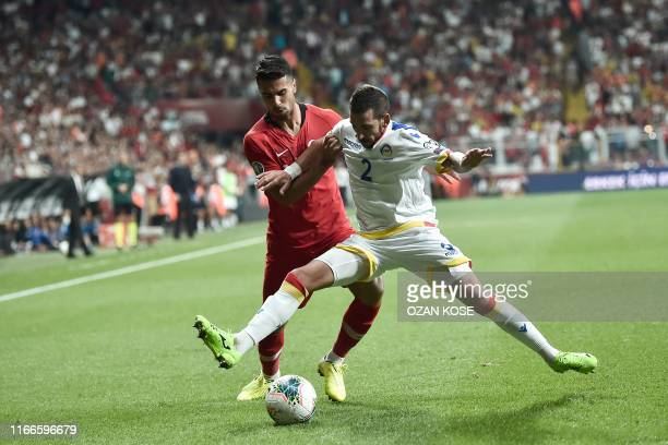 Turkey's Zeki Celik vies for the ball with Andorra's Cristian Martinez during the UEFA Euro 2020 qualifying Group H football match between Turkey and...