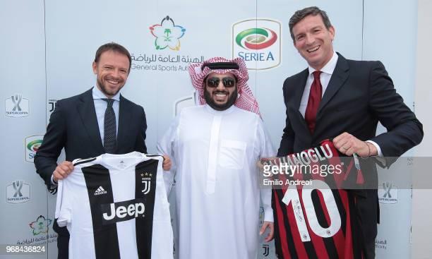 E Turki Al Sheik Chairman of the General Sport Authority Kingdom of Saudi Arabia poses with Giorgio Ricci of Juventus and Fabio Guadagnini of AC...
