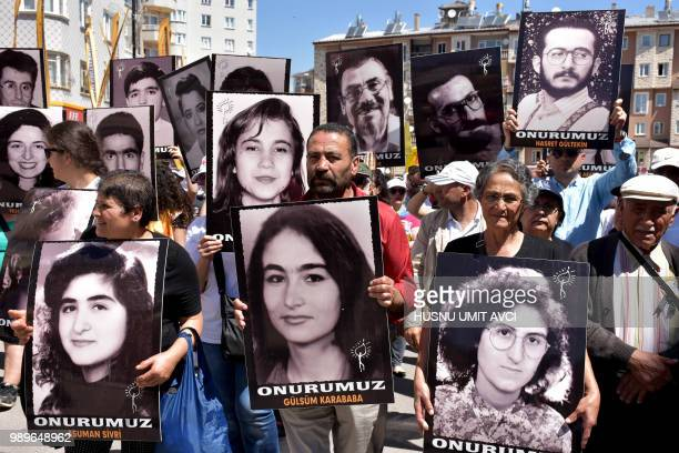 Turkish activists and opposition members gather with pictures of victims killed in Madimak Otel 25 years ago on July 2, 2018 in Sivas. - Turkish...