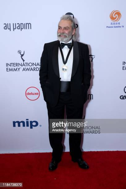 Turkish Actor Haluk Bilginer poses for a photo after he won the Best Performance by an Actor award on Monday at the 47th International Emmy Awards in...