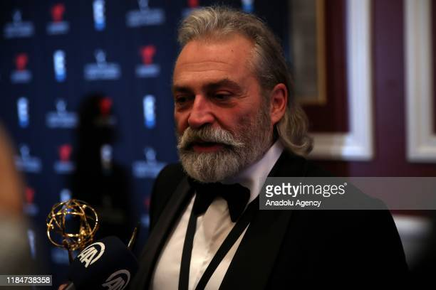 Turkish Actor Haluk Bilginer speaks to press after he won the Best Performance by an Actor award on Monday at the 47th International Emmy Awards in...