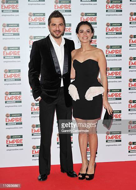 Turkish actors Engin Altan Duzyatan and Ozge Ozpirincci attend the Jameson Empire Awards at the Grosvenor House Hotel on March 27 2011 in London...