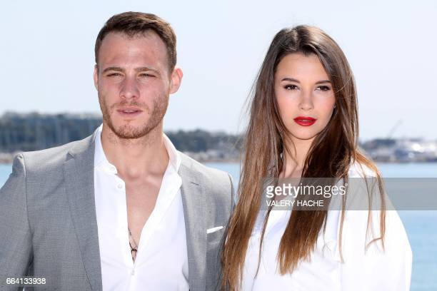 Turkish actors Kerem Bursin and Leyla Lydia Tugutlu who star in the series 'Heart of the city' pose during a photocall as part of the MIPTV event on...