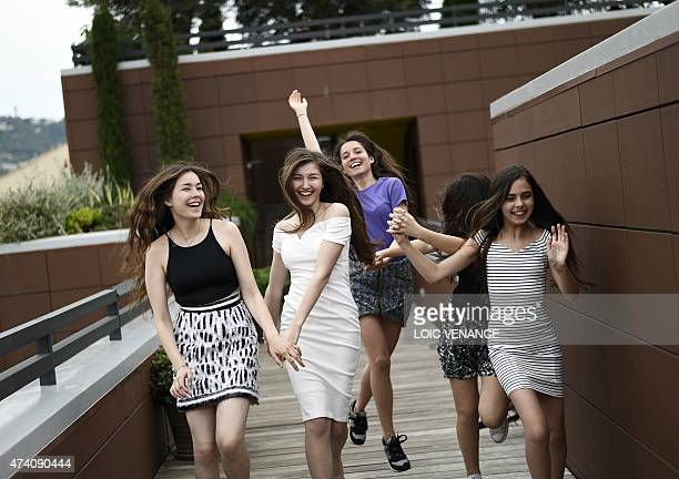 Turkish actresses Tugba Sunguroglu Ilayda Akdogan Elit Iscan Doga Zeynep Doguslu and Gunes Sensoy laugh during a photocall for the film Mustang on...