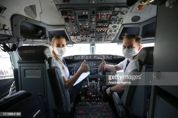 "Turkish Airline's captain pilots Selin Sevimli and second captain pilot Zafer Dogukan Demir arrive at a plane, flight number ""TK1919"", with 9 million..."