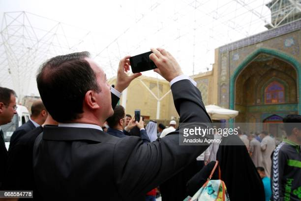 Turkish Ambassador to Baghdad Fatih Yildiz takes photo of the Shrine of Imam Ali after meeting with a Turkmen leader from Tal Afar and other opinion...