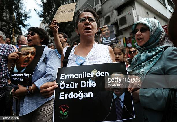 Turkish and Armenian protestors hold placards showing a photo of Turkish Prime Minister Recep Tayyip Erdogan and reading Hate by Erdogan and...