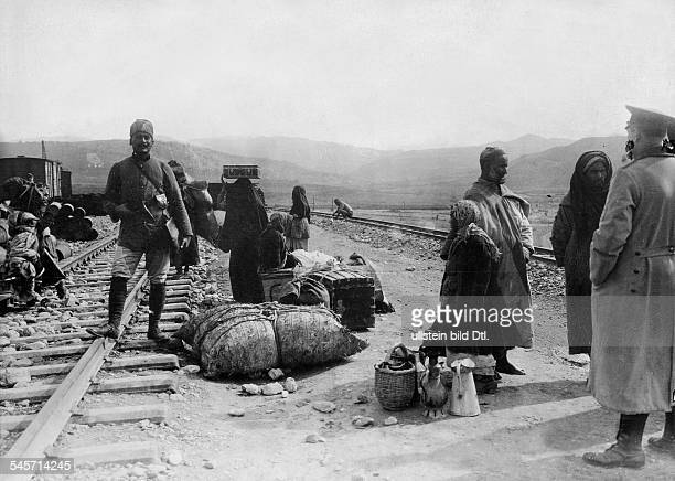 Turkish and German soldier and civilians at a railway stop in Anatolia