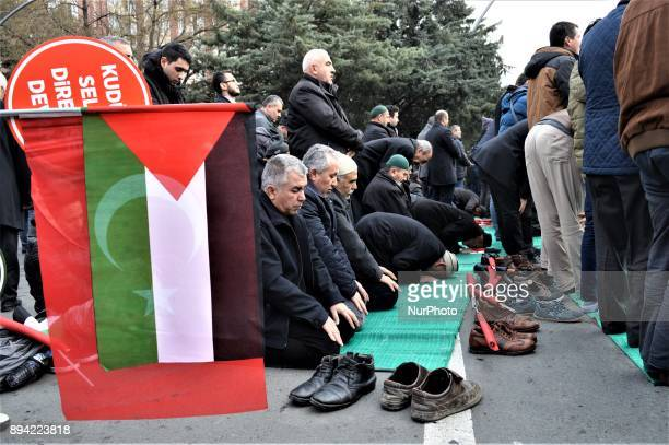Turkish and Palestinian flags are displayed while men perform a prayer as proPalestinian protesters take part in a rally against US President Donald...