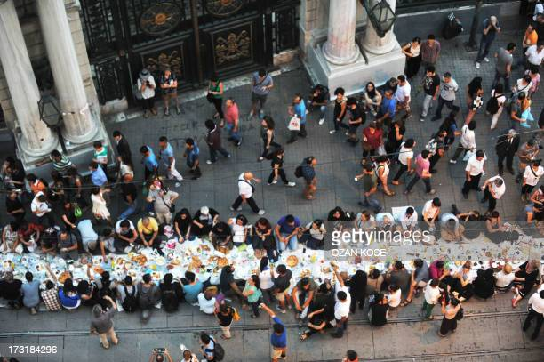 Turkish anti goverment protesters break their first day of fasting for the Muslim holy month of Ramadan on Istiklal street, the main shopping...