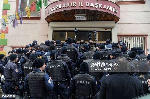 TOPSHOT Turkish anti riot police officers block People' Democracy Party's headquarter as HDP members call a protest against Turkey's 'Olive Branch'...