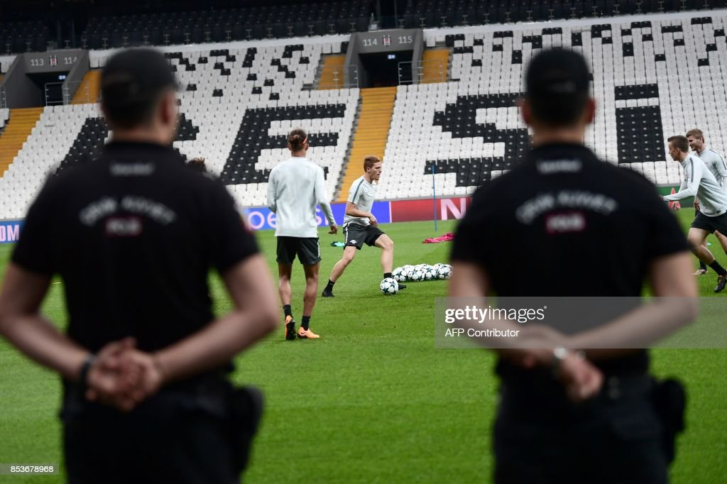 Turkish anti riot police officers stand guard as Leipzig's players take part in a training session on September 25, 2017, in Istanbul on the eve of the UEFA Champions League Group G football match Leipzig vs Besiktas. /