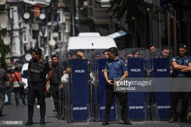 Turkish anti riot police officers stand guard in front of peoples democracy party's headquarter during a press conference on August 20,2019 in...