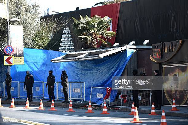 Turkish anti riot police officers stand guard in front of the Reina night club on January 2 2017 in Istanbul one day after a gunman killed 39 people...