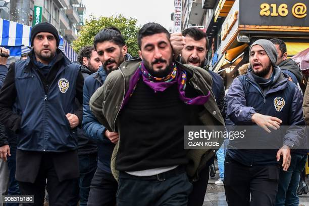 TOPSHOT Turkish antiriot police officers arrest a man during a demonstration called by Halklarin Demokratik Partisi members to protest against...