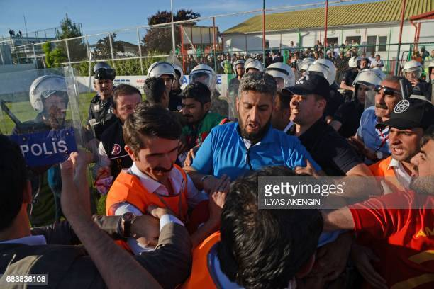Turkish antiriot police officers clash with Amedspor fans on May 16 2017 during the Turkish Super Lig white group semifinal second leg football match...