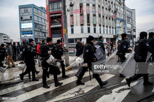 TOPSHOT Turkish antiriot police officers patrol in the streets as they hold their shields during a demonstration called by Halklarin Demokratik...