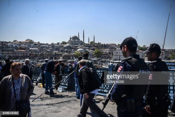 Turkish antiriot police officers patrol on the Galata bridge on April 19 2018 in Istanbul President Recep Tayyip Erdogan on April 18 2018 called snap...