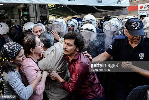Turkish antiriot police push back protesters with their shields on October 26 2016 during a demonstration against the detention of the...