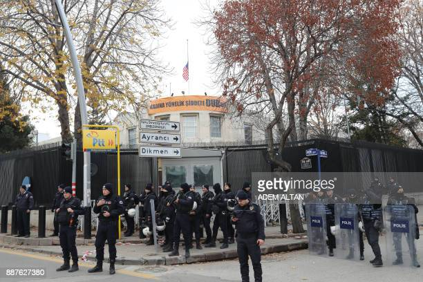 Turkish anti-riot police secure the area around the US Embassy in Ankara during a protest against the US president's decision to officially recognise...