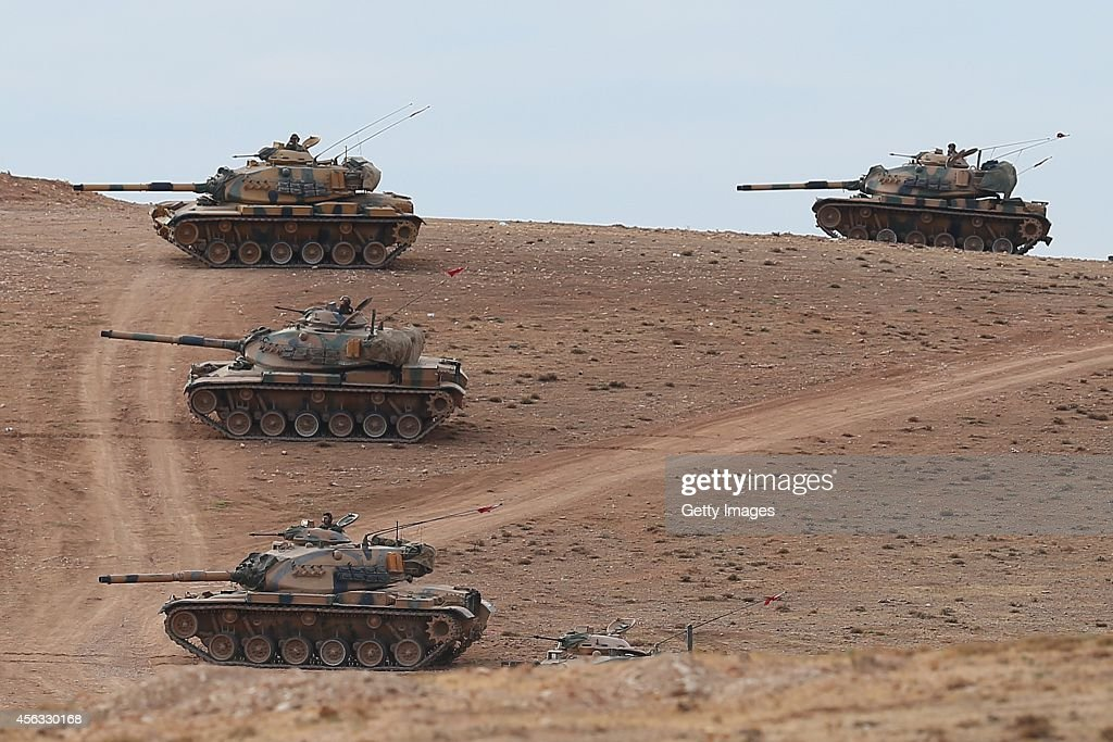 Clashes Between ISIL Militants Continue On Turkish Border With Syria : News Photo
