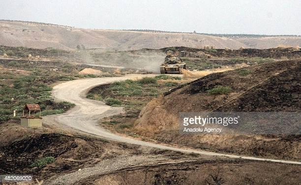 Turkish armored vehicles are deployed at the JarabulusKarkamis border to tighten security in Gaziantep Turkey on July 26 2015