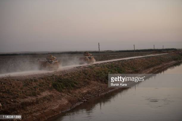 Turkish armored vehicles prepare to cross the border into Syria on October 09, 2019 in Akcakale, Turkey. The military action is part of a campaign to...