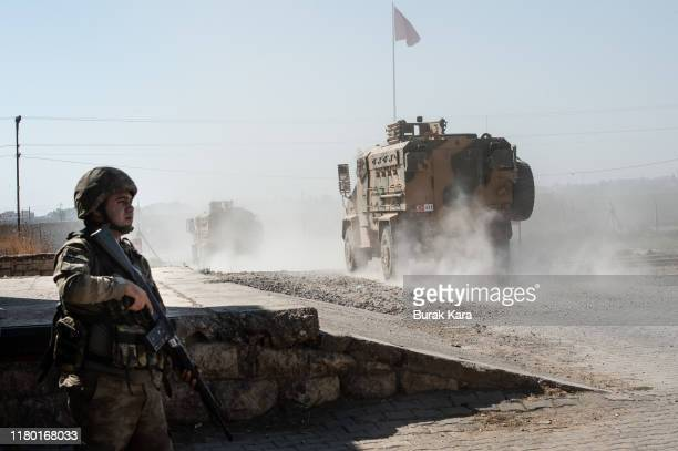 Turkish armoured vehicles enter Syria on October 10, 2019 in Akcakale, Turkey. The military action is part of a campaign to extend Turkish control of...