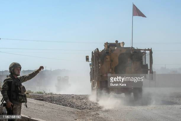 Turkish armoured vehicles escort members of the Turkish-backed Free Syrian Army, a militant group active in parts of northwest Syria, as they enter...