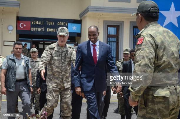 Turkish army Chief of General Staff Hulusi Akar escorts Somalia Prime Minister Hassan Ali Kheire during an inauguration ceremony of the Turkish...