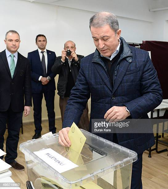 Turkish Army Chief of Staff General Hulusi Akar casts his vote at a polling station during a general election on November 1 in Ankara, Turkey. Polls...