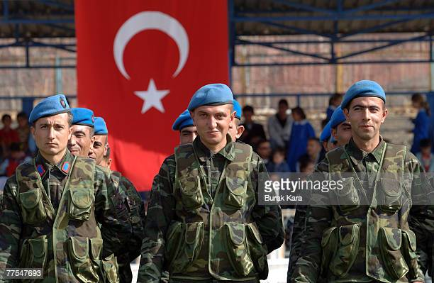 Turkish army commandos participate in a military parade as part of Turkey's celebrations for Republic Day in the city of Sirnak on October 29 2007 in...