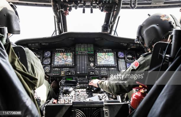 turkish army pilot riding military helicopter - inside helicopter imagens e fotografias de stock