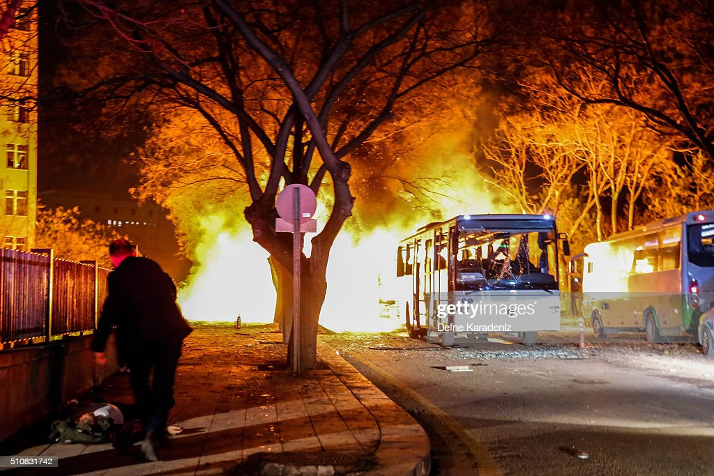 Turkish army service busses burn after an explosion on February 17, 2016 in Ankara, Turkey. 21 people are believed to have been killed and at least 61 are said to be wounded according to the city's governor Mehmet Kiliclar in what appeared to have been a car bomb attack on a vehicle carrying military personnel in the Turkish capital.