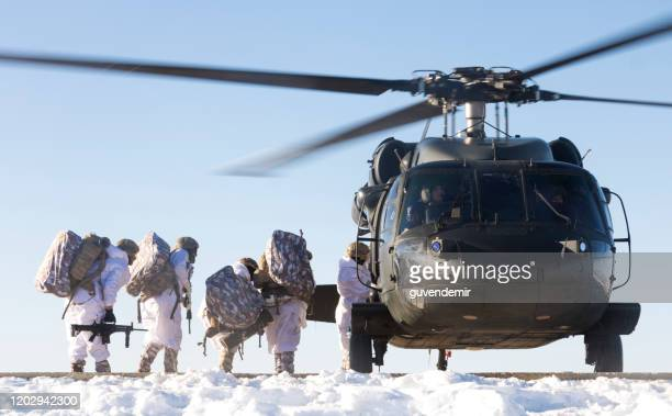 turkish army soldiers boarding a sikorsky uh-60 black hawk military helicopter - sikorsky uh 60 black hawk stock pictures, royalty-free photos & images