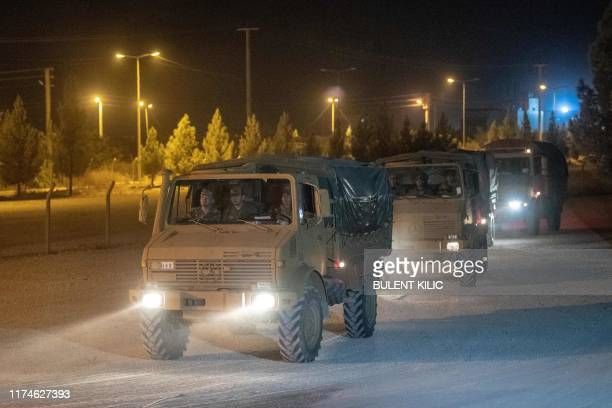 Turkish army soldiers drive towards the border with Syria near Akcakale in Sanliurfa province on October 8 2019 Turkey said on October 8 it was ready...