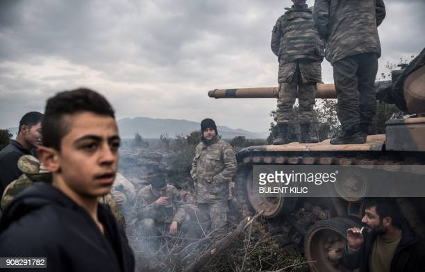 Turkish army soldiers wait near the border before entering Syria on January 21 2018 at Hassa in the Turkish province of Hatay near the Syrian border...